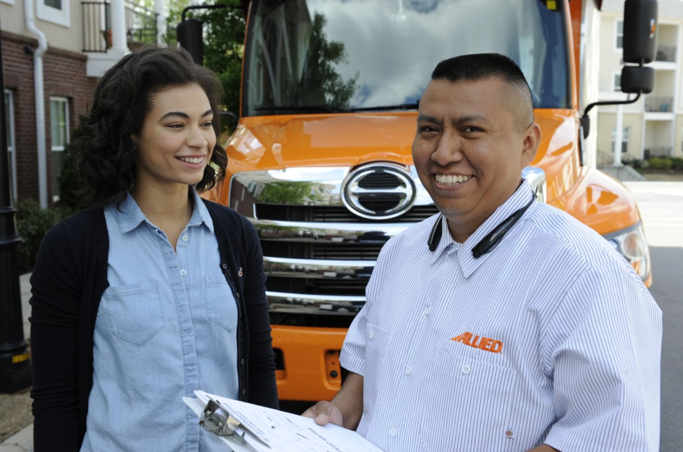 Allied Moving Agent With Happy Customer