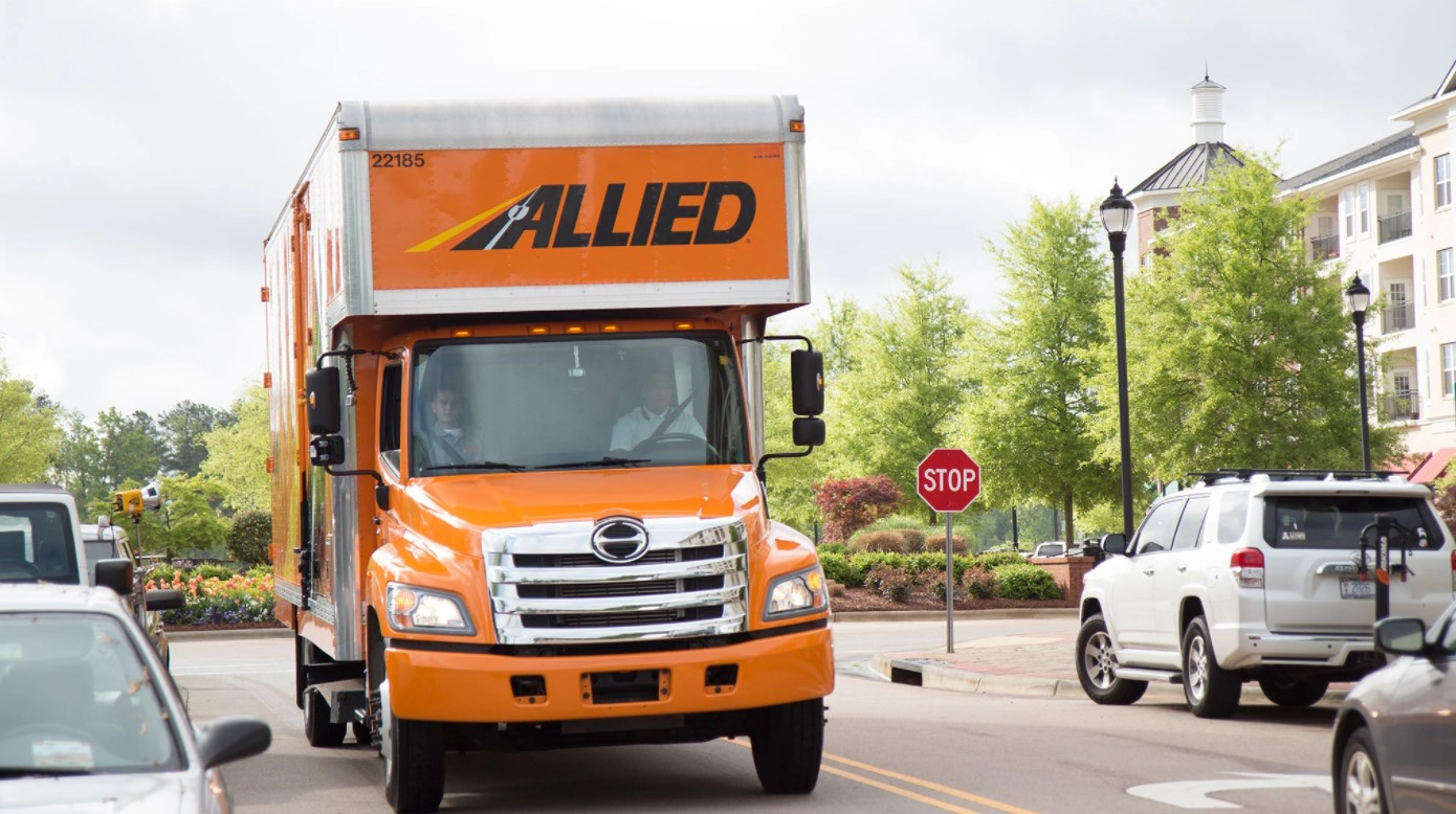 Allied Moving Truck Driving Along City Street