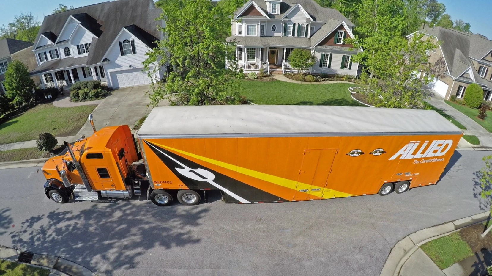 Allied Moving Truck Parked in Front of a Home Top View
