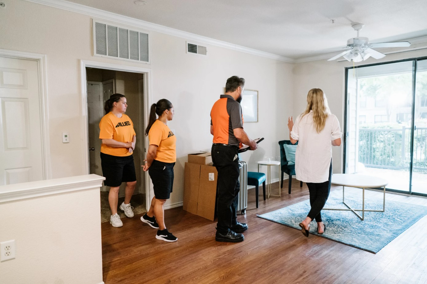 Woman showing movers an apartment